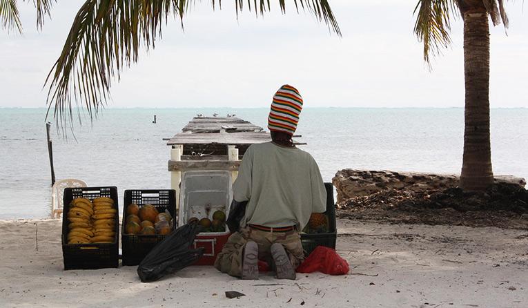 Fruit vendor in the beach of Belize.