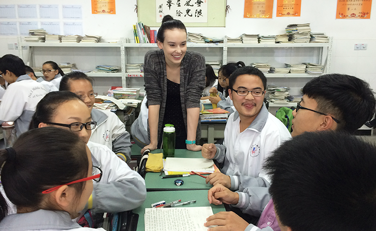 Chinese students smiling in a classroom