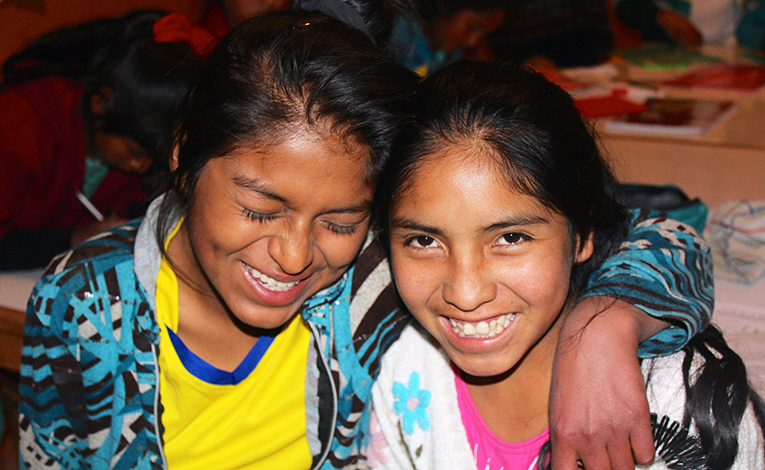 South American indigenous girls laughing