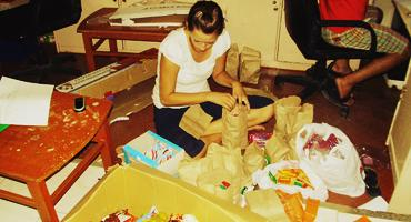 NGO sponsorship program volunteer assistant packing food distribution