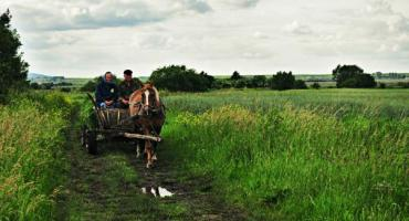 Couple riding through the countryside of Ukraine.