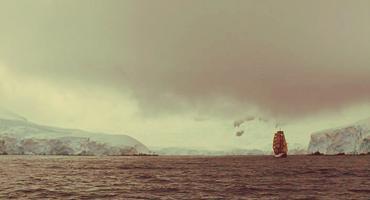 A ship sails south toward Antarctica