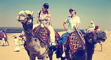Students riding camels in Egypt