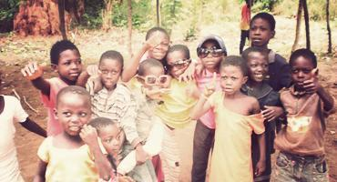 Children are all smiles for the camera in Ghana