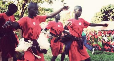 Traditional dance by local students in Kampala