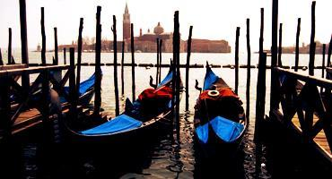 Colorful gondolas parked in the waterways of Venice, Italy