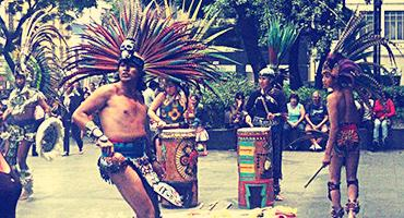 A traditional Aztec dance in a public square in Mexico