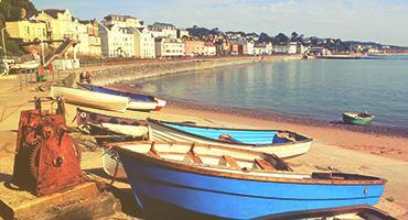 A dock by the beach coastline in England.