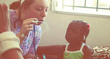 Nursing student working with a local child in Haiti