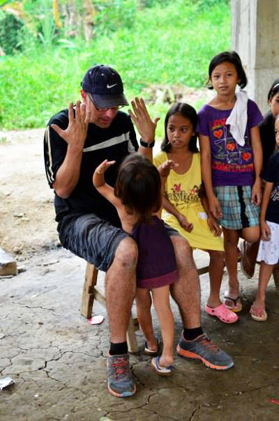A volunteer playing with the kids