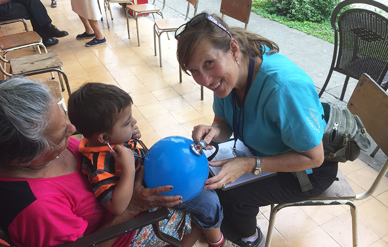Volunteer nurse in Colombia taking a child's vitals
