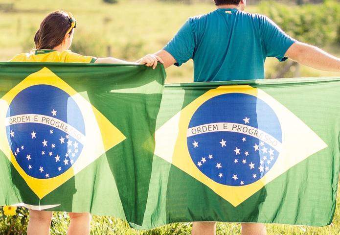 man and woman with Brazilian flag