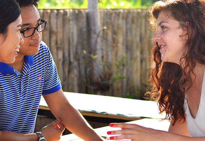 Friends talking at a picnic table