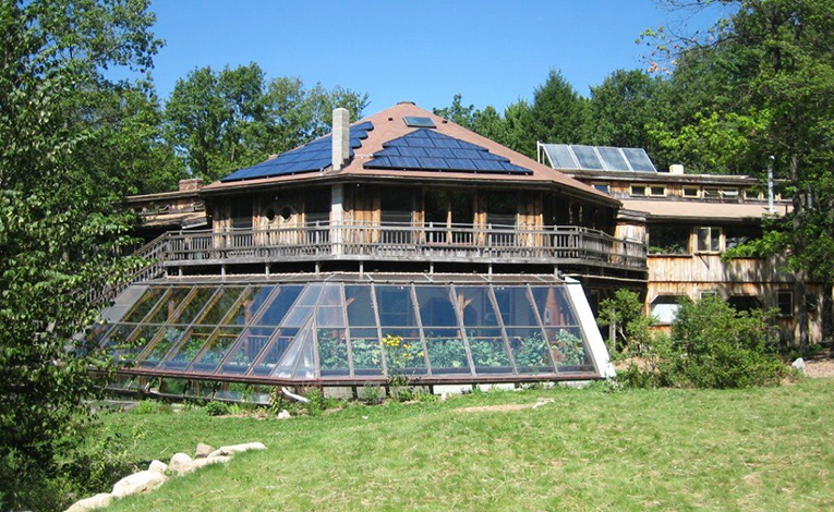 Greenhouse with rooftop solar panels