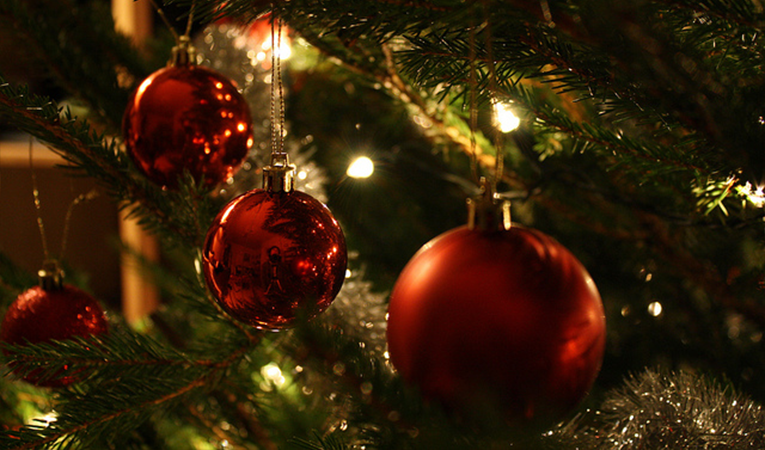 Closeup of red ornaments on a Christmas tree