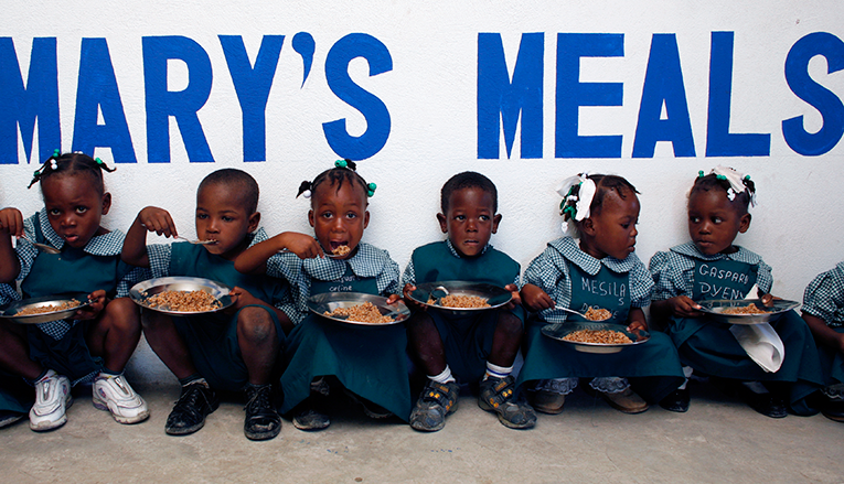 young children eating provided meals.