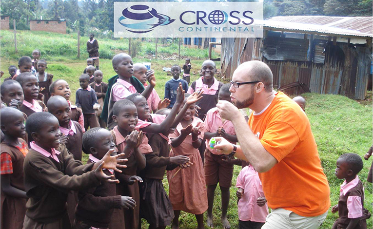 Volunteer blowing bubbles with kids in Africa