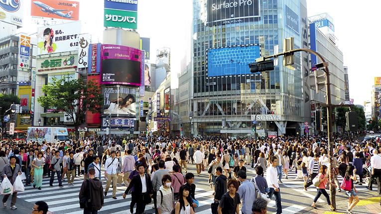 Busy street full of pedestrians in Tokyo, Japan