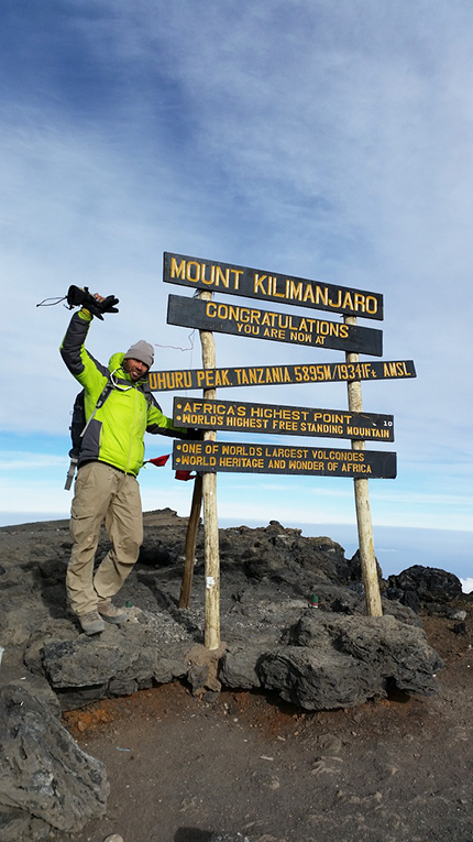A mountaineer at the top of Mount Kilimanjaro