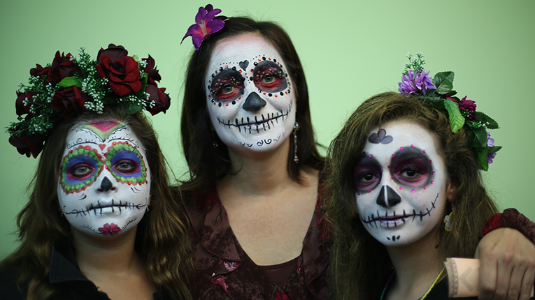 Women with facepaint during the Day of the Dead