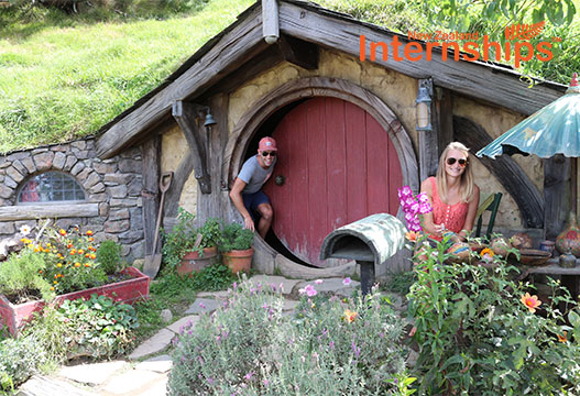 Tourists at a hobbit house in New Zealand