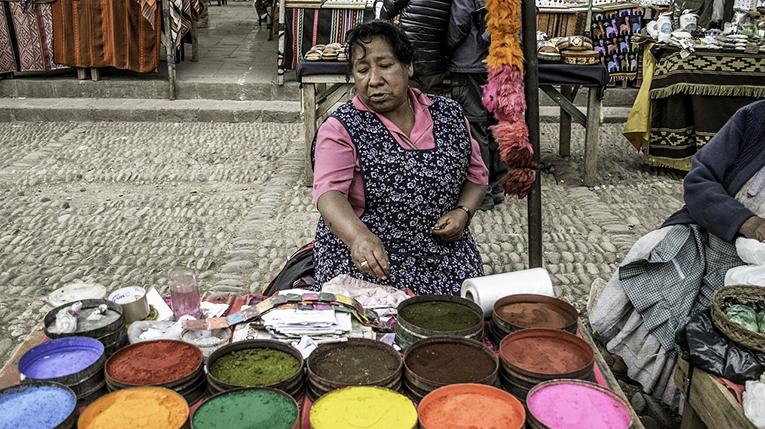 A woman selling dye in Peru