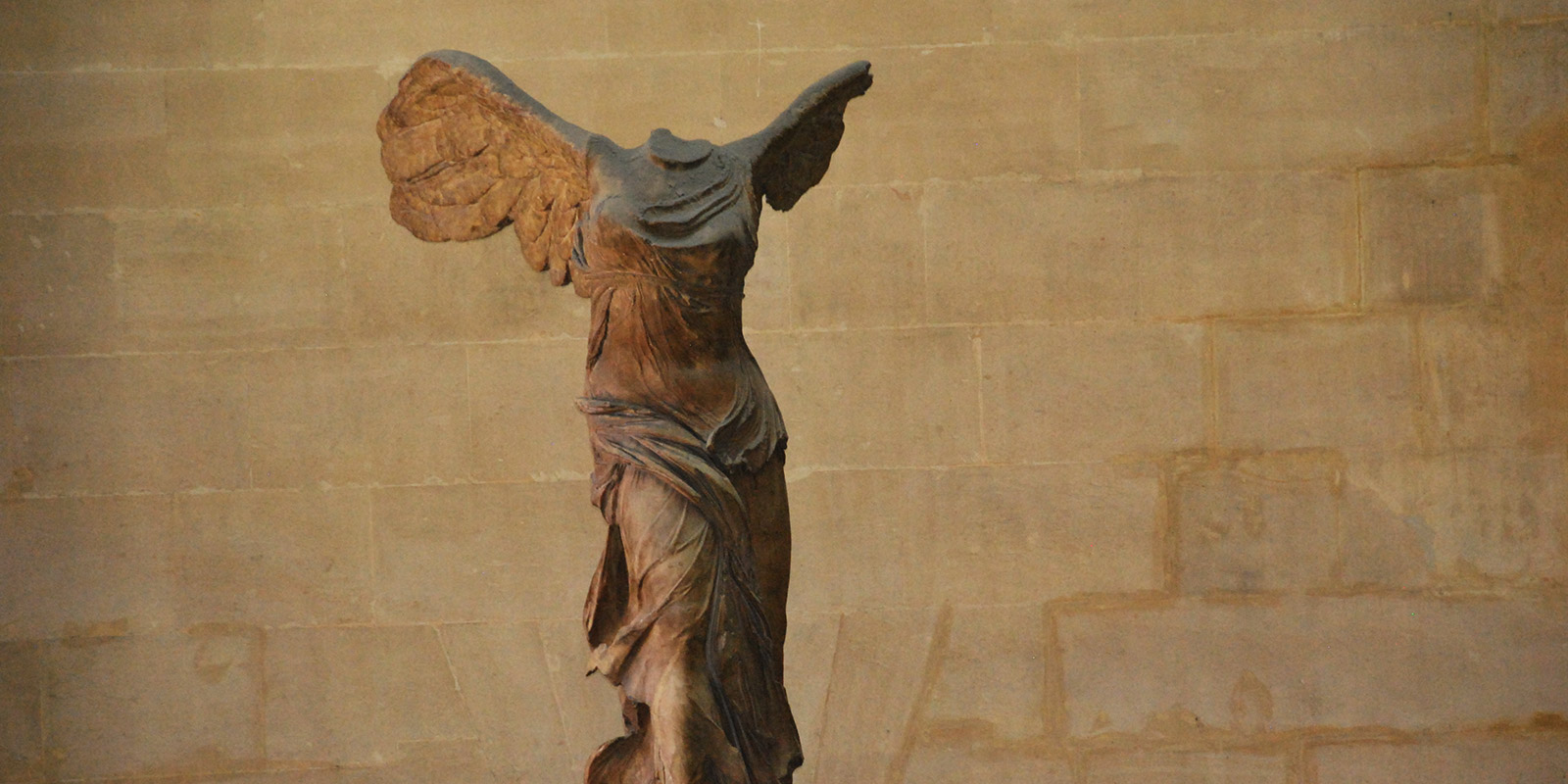 A headless angel statue in Louvre France