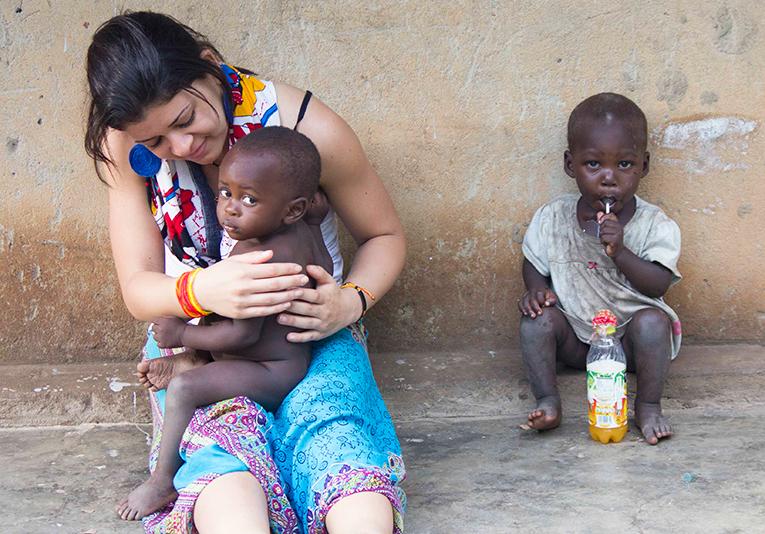 A volunteer with kids in Uganda