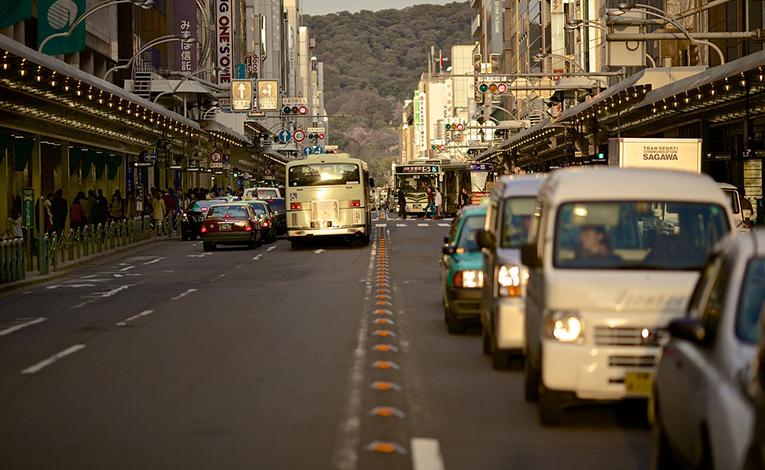 Public transportation down a busy street.
