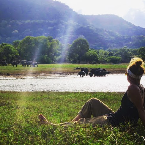 A woman sitting on a field