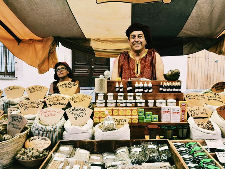Spice vendor at a market in Calella, Spain