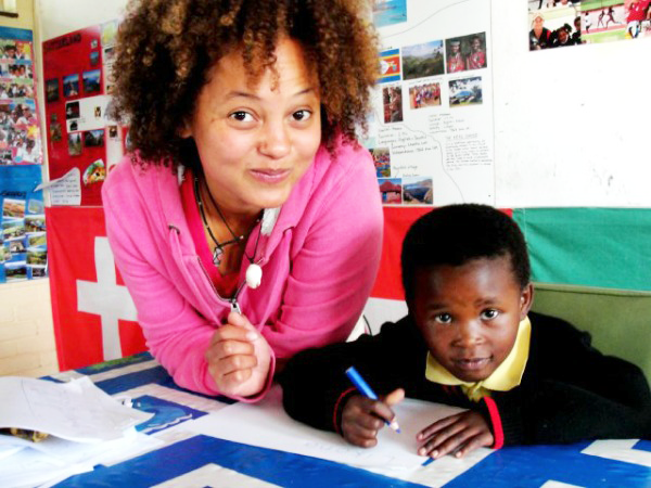 Teaching volunteer in South Africa with student