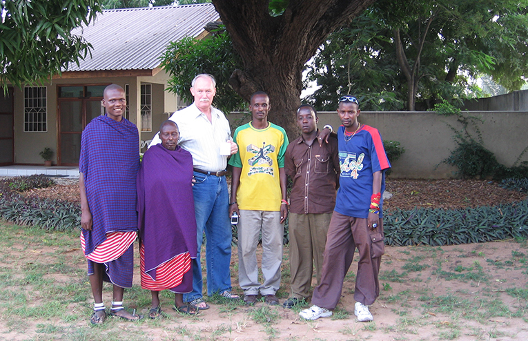 Foreign teacher with students in Africa