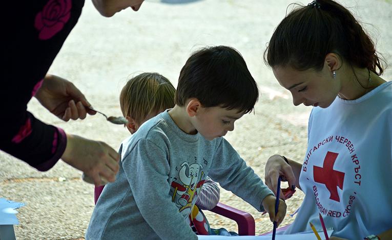 Medical volunteer with children