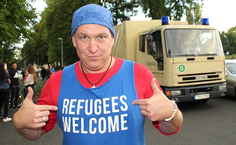 Man wearing refugee-friendly t-shirt.