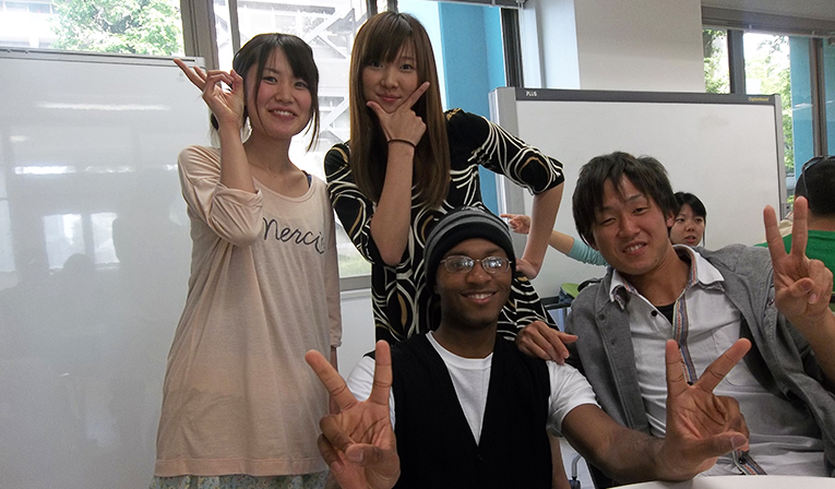 Students posing a peace sign