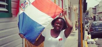 An intern holds the flag of the Dominican Republic