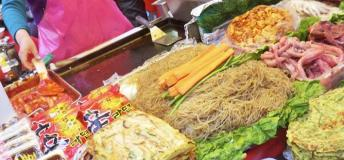 Take a sample of Korean street food before enjoying a night out with friends.