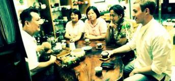 The author, tasting tea with the locals in Taiwan.