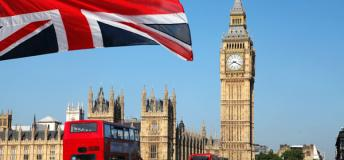 Iconic Big Ben stands behind the British flag.
