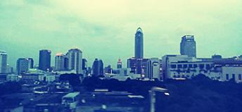 The Bangkok skyline from the window of the Sky Train.