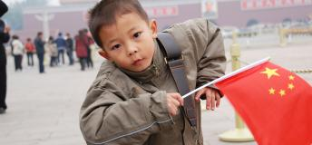 A child in Beijing carrying their national flag.
