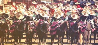 Mexican men riding horses