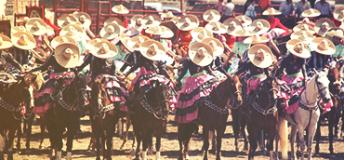 Mexican men riding horses