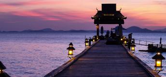 Sunset behind a pier in Thailand