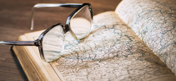 A book and a pair of eyeglasses