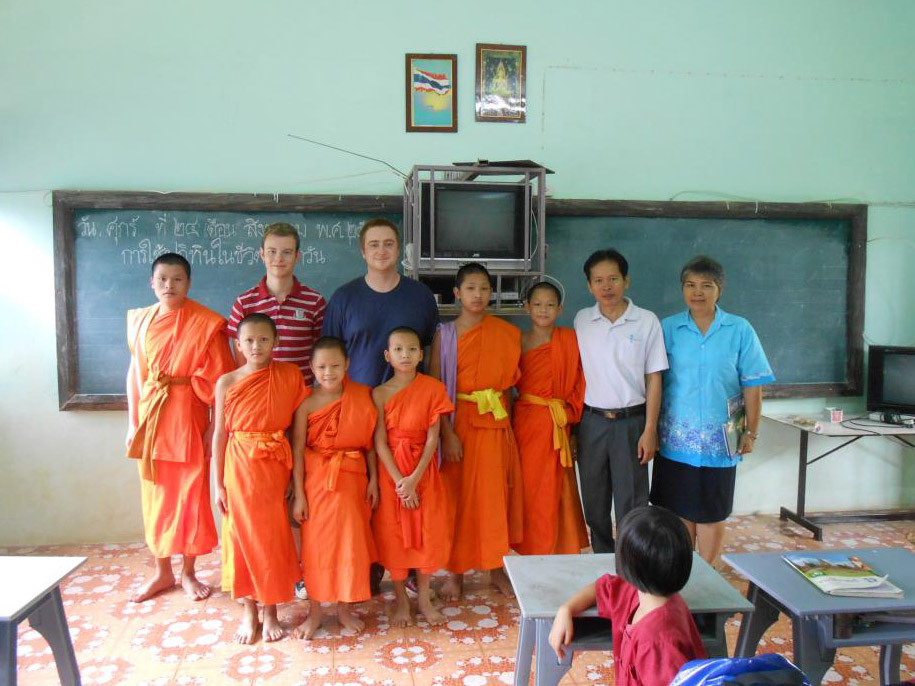 English teacher with young monks in Chiang Mai, Thailand.