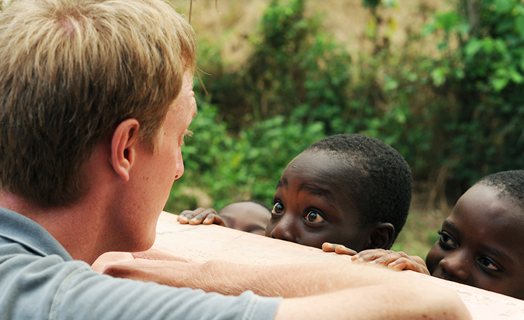 Volunteer looking at a local child in Africa