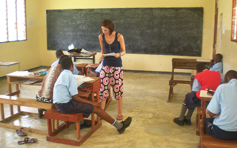 International teacher working with students in Kenya