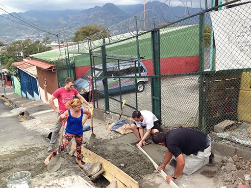 Construction volunteers mixing concrete in Costa Rica